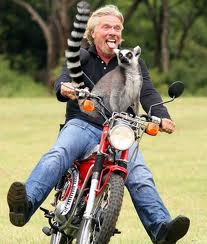 Branson on motorcycle with lemur