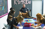 Officer and police dog in classroom