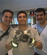 Airport Personnel with Kittens at Airport