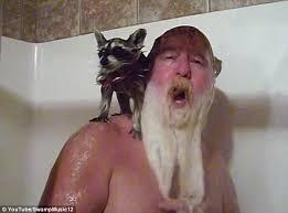 Man Showering with Pet Raccoon