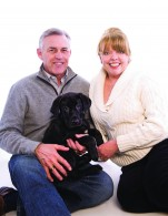 Susan and Gregg Sims with their dog junior