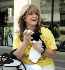 Susan Olsen feeding kitten