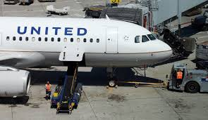 United Airline pays passenger to keep quiet about dog.